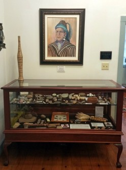 "Many descendants of Chief Menewa, the ""Great Warrior,"" come to the museum to learn more about Creek Indian history. The Lee room contains a display of arrow heads, tomahawks and other Indian-Era artifacts."