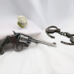 Pistol, Handcuffs and Badge