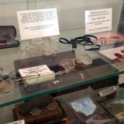 A collection of eyeglasses can be found in the old courtroom.