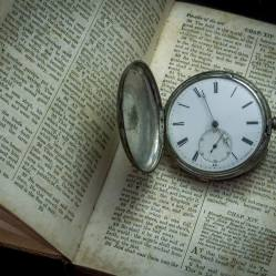 Silver Pocket Watch and Bible